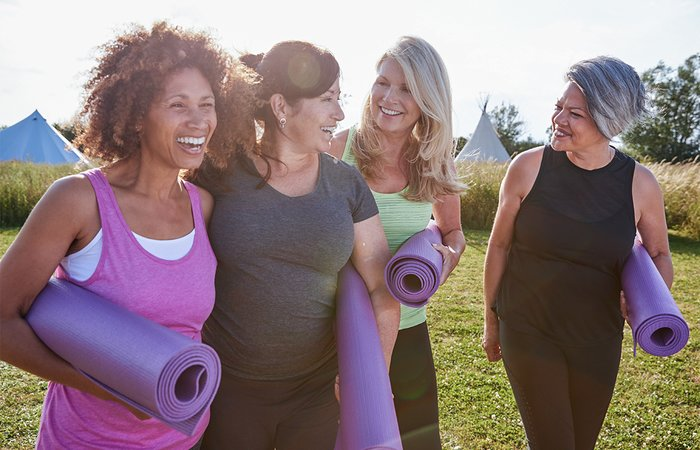 Women with yoga mats